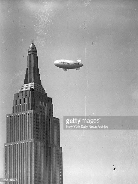 Goodyear blimp flies near the Empire State Building