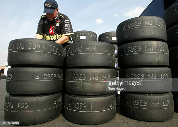 A Goodyear mechanic inspects tires for the NASCAR Winston Cup Series Checker Auto Parts 500 at Phoenix International Raceway in Phoenix Arizona