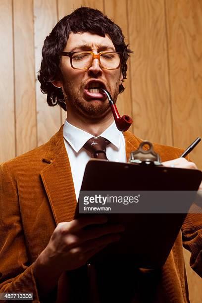 Goofy 1970s College Professor Taking Class Attendance on Clipboard