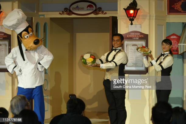 Goofy and waiters are showing five signature dishes to the guests at Hong Kong Disney Hotel during the Hong Kong Disneyland and Lee Kum Kee alliance...