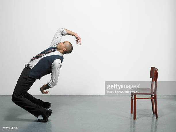 goofy businessman bending over backwards - dipping stock photos and pictures