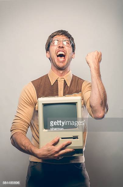 goofy excited glasses nerdy it computer guy - nerd stock pictures, royalty-free photos & images