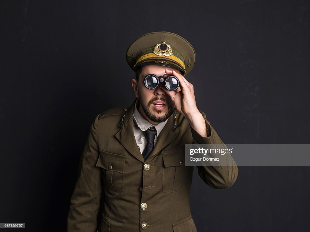 Goofy general holding binoculars : Stock Photo