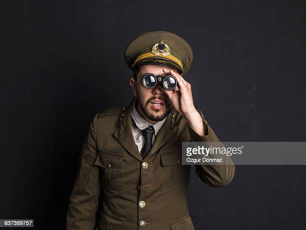 goofy general holding binoculars - uniform cap stock pictures, royalty-free photos & images