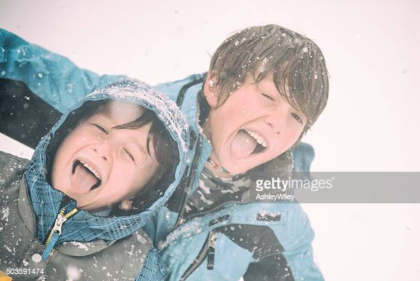 Goofy kids being silly and funny making faces durning storm
