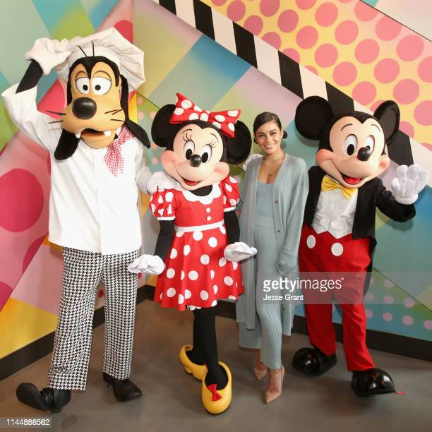 Goofy, Minnie Mouse and Mickey Mouse join actor Vanessa Hudgens to celebrate the opening of Black Tap Craft Burgers & Shakes, May 18 in the Downtown...