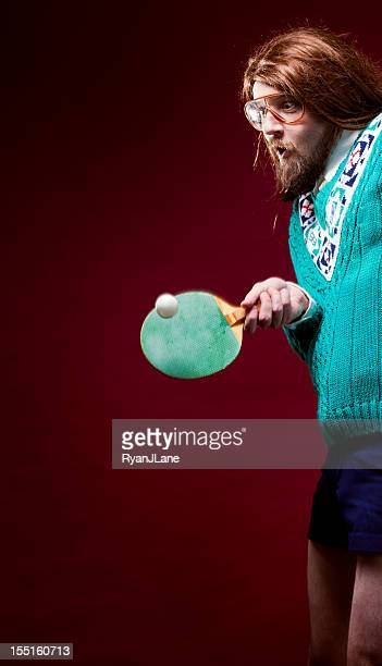 goofy nerd with bad sweater plays table tennis - funny ping pong stock pictures, royalty-free photos & images