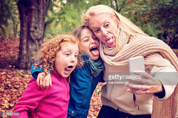 """goofy selfie of mother and daughters outdoors in autumn nature. - """"martine doucet"""" or martinedoucet stock pictures, royalty-free photos & images"""