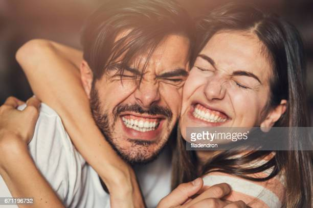 goofy young couple - heterosexual couple stock pictures, royalty-free photos & images