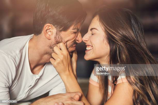 goofy young couple - cheek stock pictures, royalty-free photos & images