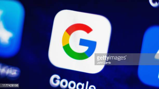google app icon on smartphone screen - google icon stock pictures, royalty-free photos & images
