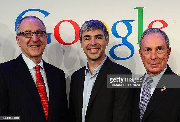 Google CEO Larry Page New York Mayor Michael Bloomberg and Cornell University President David Skorton pose for a photo during a press annoucement at...