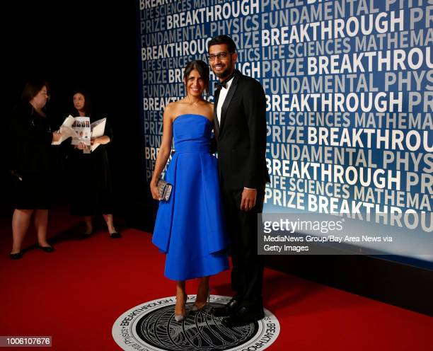 Google CEO Sundar Pichai right with his wife Anjali pose for the cameras at the 2016 Breakthrough Prize red carpet event at NASA Ames Research Center...