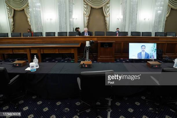 Google CEO Sundar Pichai testifies remotely during a Senate Commerce Science and Transportation Committee hearing with big tech companies October 28...