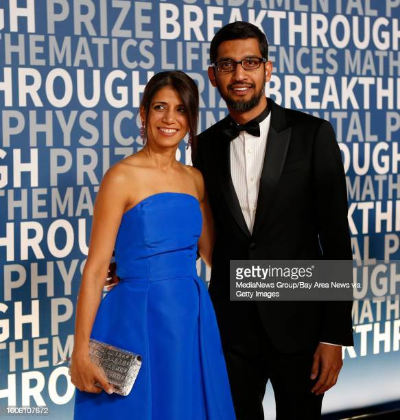 Google CEO Sundar Pichai with wife Anjali pose for the cameras at the 2016 Breakthrough Prize awards ceremony red carpet event at NASA Ames Research...