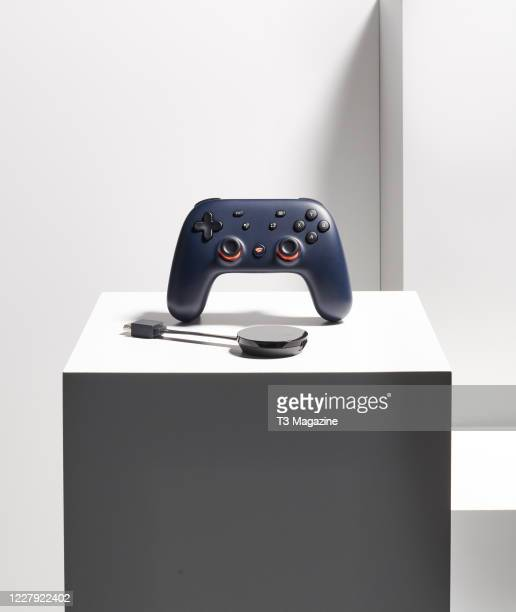 A Google Chromecast Ultra device and Google Stadia controller taken on February 14 2020