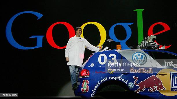Google co-founder Larry Page rides on the back of a car as he makes his entrance to deliver his keynote address at the International Consumer...