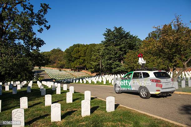 A Google employee drives thru Arlington National Cemetery with the Street View car equipped with 15 cameras Each lens points in a different direction...