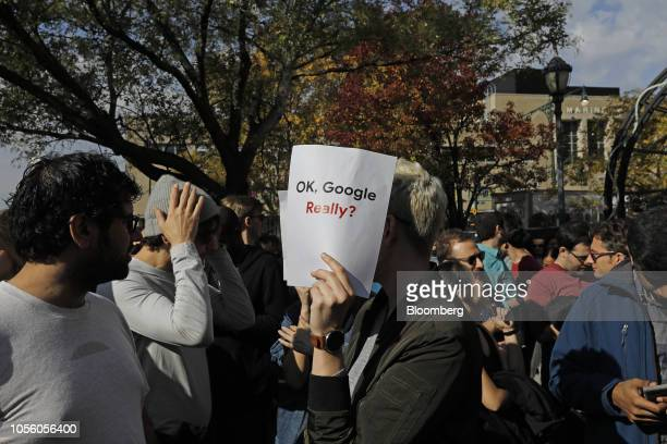 A Google employee holds a sign during a walkout to protest how the tech giant handled sexual misconduct at Jackson Square Park in New York US...