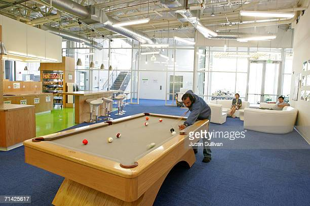 Google employee plays pool at the Googleplex May 11 2006 in Mountain View California