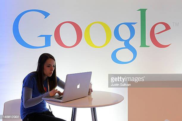 Google employee works on a laptop before the start of a new conference about Google Maps on June 6 2012 in San Francisco California Google announced...