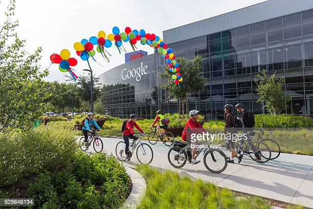 Google employees arriving after bicycling to work at the Googleplex in Mountain View CA