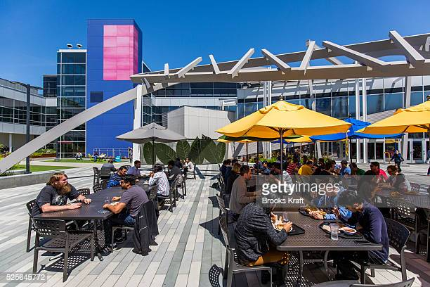 Google employees enjoy outdoor lunch at Charlie's Cafe at Google Headquarters in Mountain View California The Googleplex campus includes over 20...