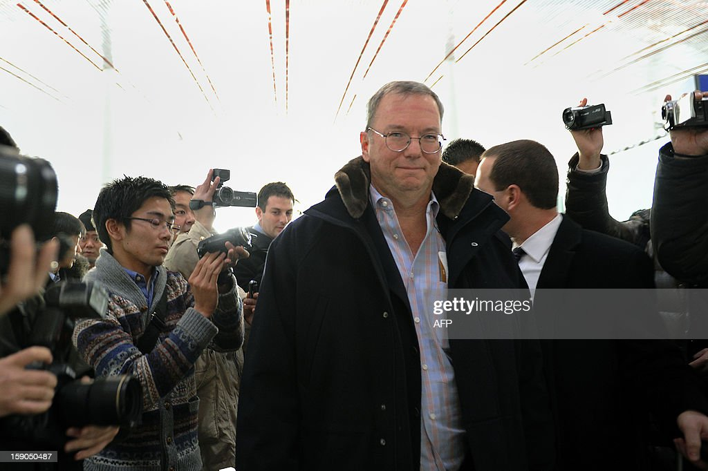 Google Executive Chairman Eric Schmidt (C) makes his way after checking in at Beijing International airport in Beijing on January 7, 2013, before his trip to North Korea. Former New Mexico governor Bill Richardson and Google chairman Eric Schmidt will head to North Korea on a 'private humanitarian mission,' Richardson's office said on January 5, 2012.