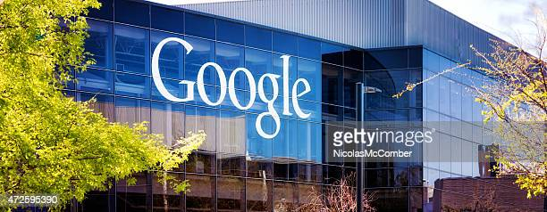 google headquarters at mountain view glass building with logo panorama - headquarters stock pictures, royalty-free photos & images