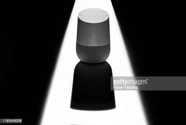 A Google Home smart speaker casting a sinister shadow to represent issues of privacy and security taken on December 12 2019