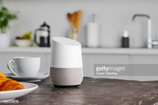 A Google Home smart speaker photographed on a kitchen counter taken on January 9 2019