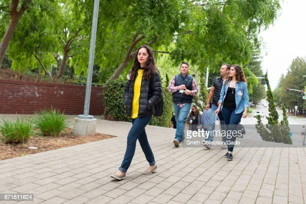 Google Inc employees and visitors including several females walk through the Googleplex headquarters of Google Inc in the Silicon Valley town of...