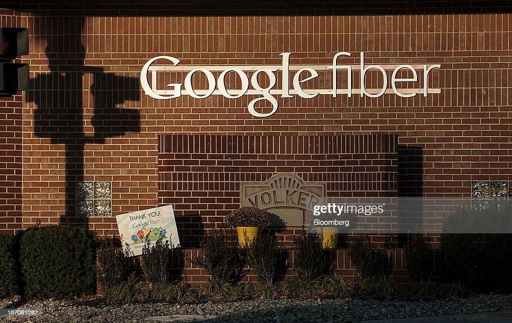 Google Inc. Fiber signage is displayed outside of the company's office in Kansas City, Missouri, U.S., on Tuesday, Nov. 27, 2012. Google Inc. will move a step closer to offering the fastest citywide Internet service in the U.S. when it picks the first neighborhoods in Kansas City to get hooked into a new fiber-optic network. Photographer: Julie Denesha/Bloomberg via Getty Images