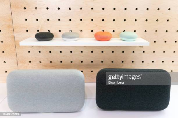 Google Inc Home Mini 2 and Home Max 2 smart speakers sit on display during the Made By Google 2018 launch event in New York US on Tuesday Oct 9 2018...