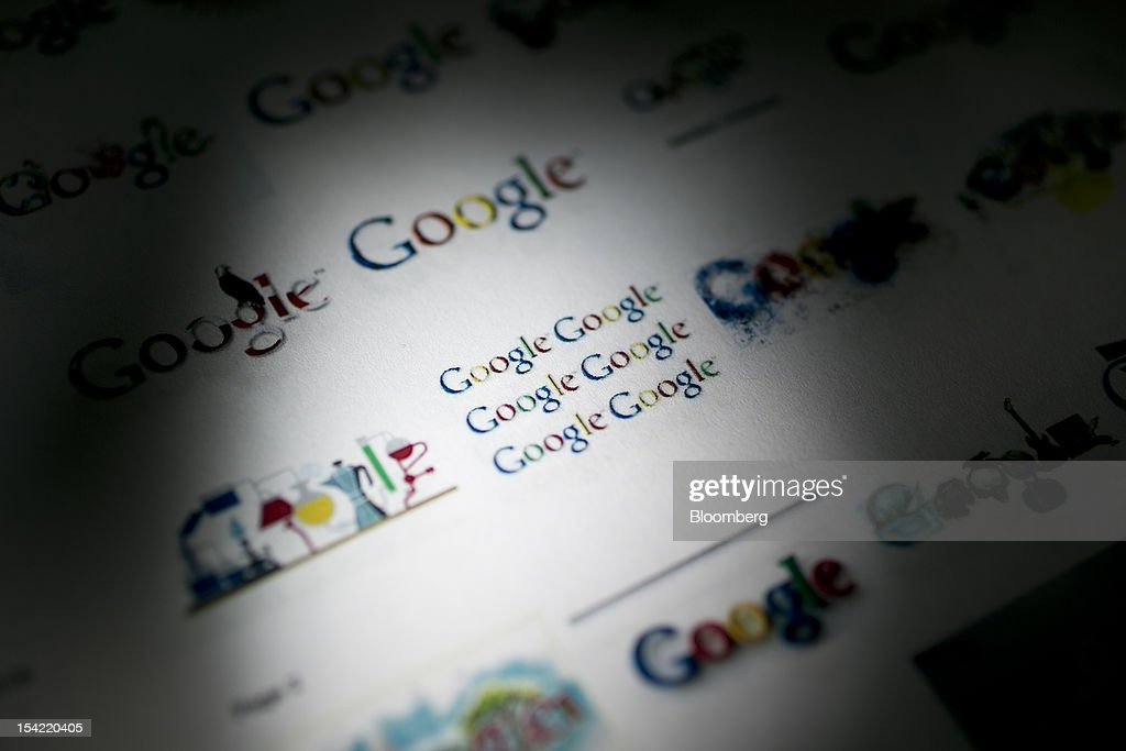 Google Inc. logos are displayed for a photograph in Washington, D.C., U.S., on Monday, Oct. 15, 2012. Google Inc. is scheduled to release earnings data on Oct. 18. Photographer: Andrew Harrer/Bloomberg via Getty Images