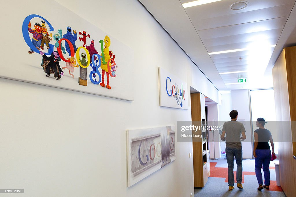 Google Inc. logos sit on a wall inside the pantry at the company's offices in Berlin, Germany, on Friday, Aug. 16, 2013. Google, based in Mountain View, California, is seeking to revive Motorola Mobility's smartphone business, recently announcing a new flagship Moto X smartphone with customizable colors that will be assembled in the U.S. Photographer: Krisztian Bocsi/Bloomberg via Getty Images