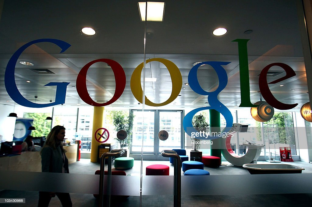 google office in uk. A Google Inc Member Of Staff Walks Through The Company Headquarters In London, U.K., Office Uk N
