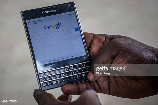 A Google Inc search page sits on the Blackberry Ltd smartphone in Abidjan Ivory Coast on Monday Aug 31 2015 The stability from the common currency...
