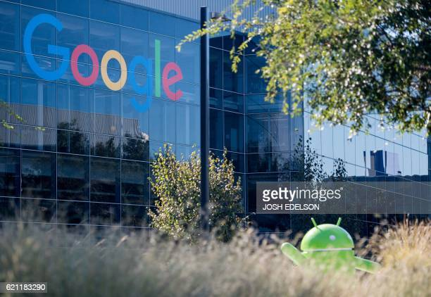 A Google logo and Android statue are seen at the Googleplex in Menlo Park California on November 4 2016 / AFP PHOTO / JOSH EDELSON