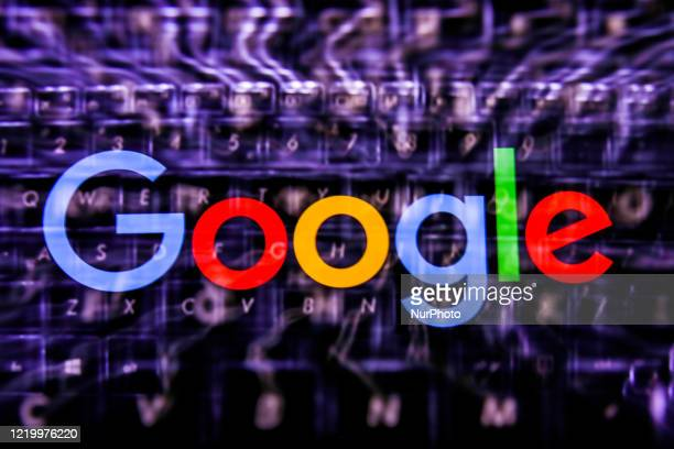 Google logo displayed on a phone screen and keyboard are seen in this multiple exposure illustration photo taken in Poland on June 14 2020 European...