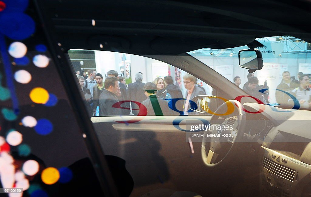 Google logo is reflected in a window of a car equiped with special cameras, used to photograph whole streets, can be seen on the Google street-view stand at the world's biggest high-tech fair, the CeBIT on March 3, 2010 in the northern German city of Hanover. Some 4,157 companies from 68 countries are displaying their latest gadgets at the fair taking place from March 2 to 6, 2010.