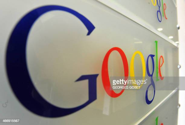 Google logo is seen on a wall at the entrance of the Google offices in Brussels on February 5 2014 The European Commission accepted the latest...
