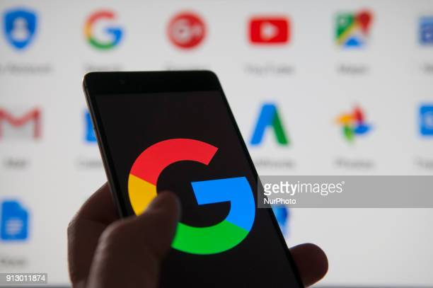 A Google logo is seen on an Android device with Google applications in the background in this photo illustration on February 1 2018