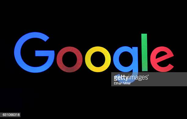 Google logo is shown on a screen during a keynote address by CEO of Huawei Consumer Business Group Richard Yu at CES 2017 at The Venetian Las Vegas...