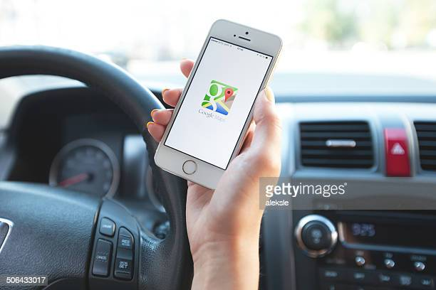 google maps navigation on apple iphone in use. - google stock pictures, royalty-free photos & images