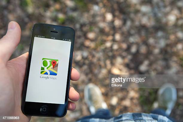 google maps on iphone - google stock pictures, royalty-free photos & images
