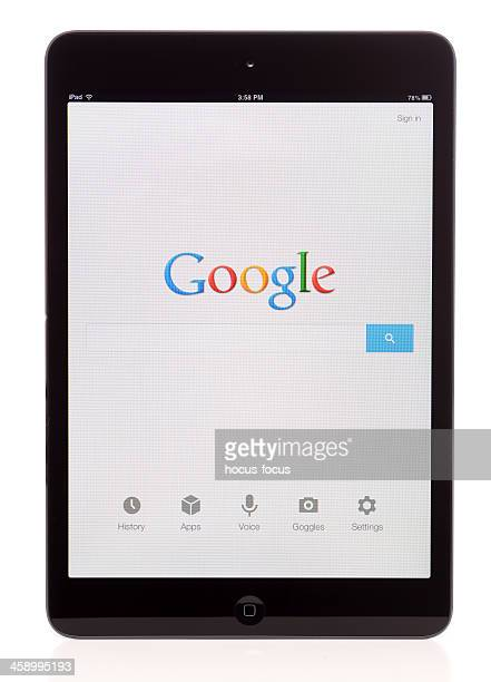 google on ipad mini - mobil brand name stock pictures, royalty-free photos & images