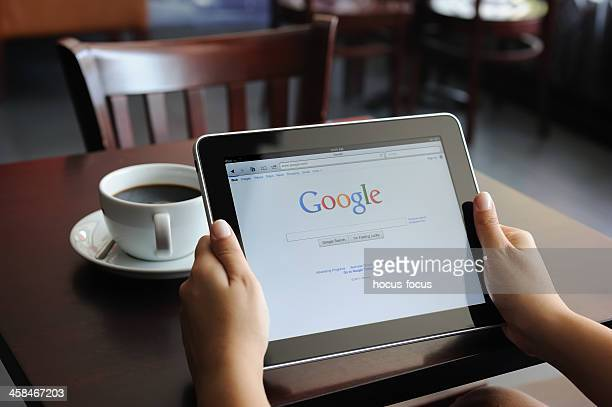 google on ipad - brand name stock pictures, royalty-free photos & images