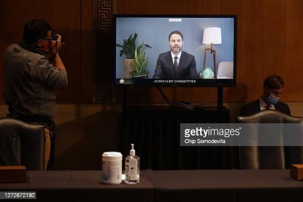 Google President for Global Partnerships and Corporate Development Donald Harrison testifies via live video feed before the Senate Judiciary...