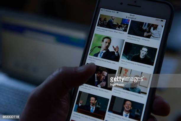 A Google search revealing photos of Facebook founder and CEO Mark Zuckerberg is seen on an iPhone on April 30 2018